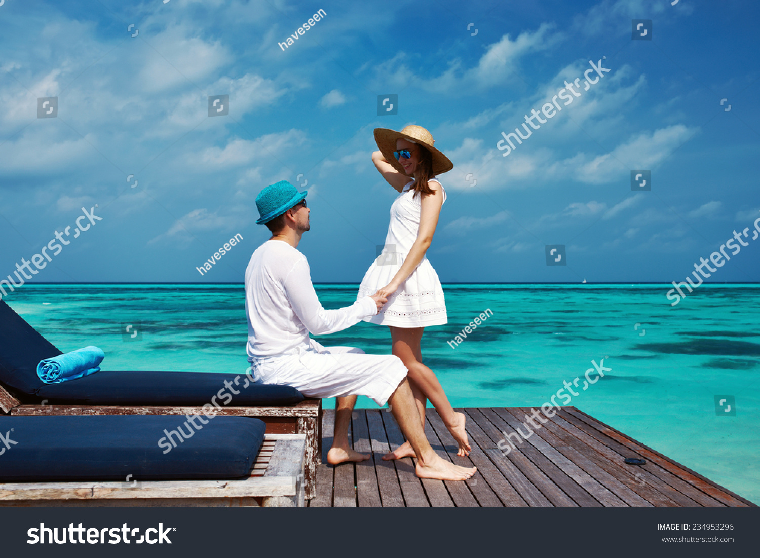 Couple on a tropical beach jetty at Maldives #234953296