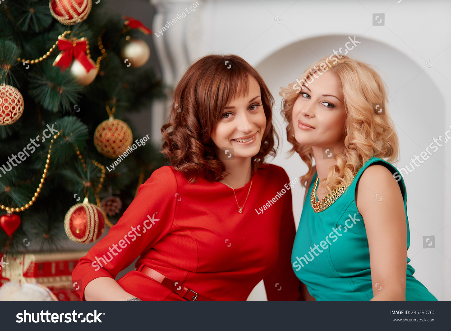 481873500 Two stunning beautiful woman in Christmas attire. Lovely lesbian couple.  Portrait of two gorgeous