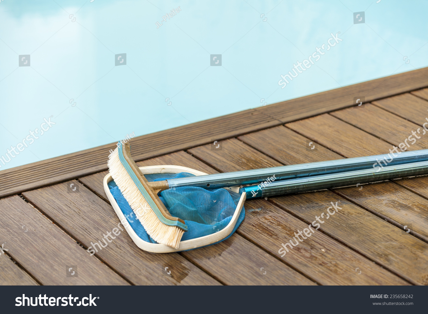 Wall brush leaf skimmer maintenance tools stock photo for Pool deck design tool