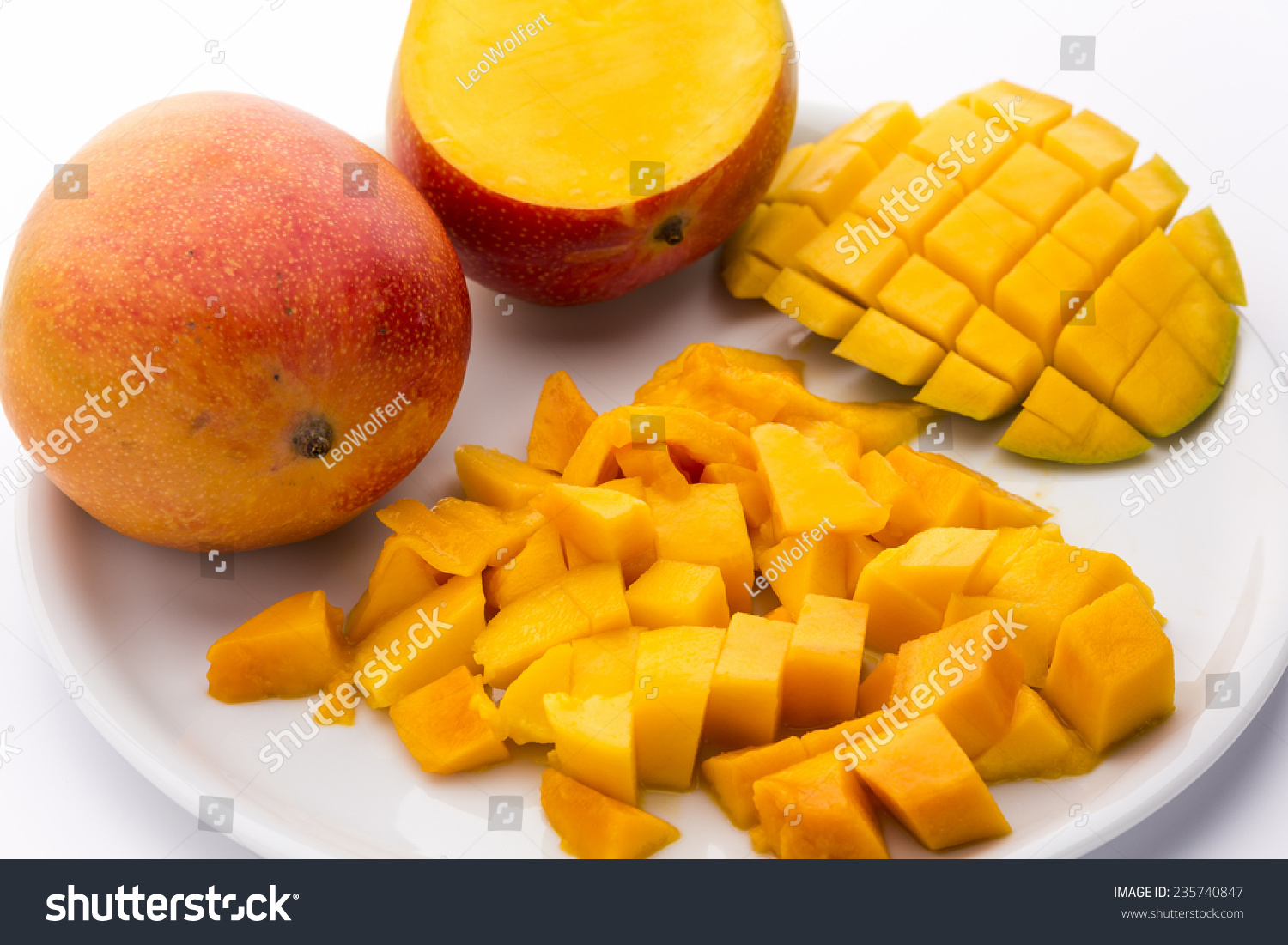 Many Juicy Mango Pulp Cubes A Third Of A Mango Cut In A Rectangular Pattern  Many 20160323cuttingmangovickywasikpeelingg