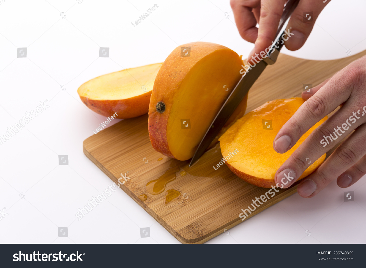 Trisecting A Mango With A Second Cut Along Its Oblong, Flat Pit Finger Tips  Trisecting