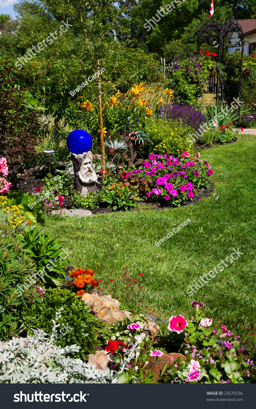 Beautiful curving flower bed full blooming stock photo edit now a beautiful curving flower bed full of blooming annuals perennials line a sunny izmirmasajfo