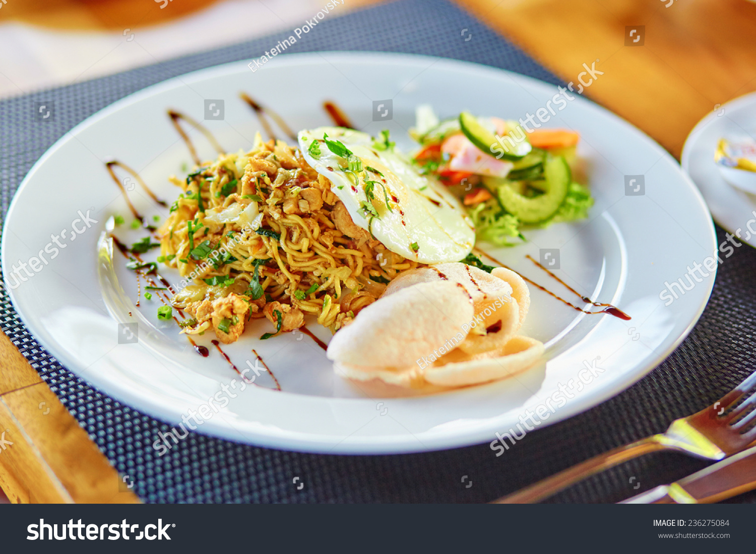 Mie goreng - spicy fried curry instant noodles, traditional Indonesian ...