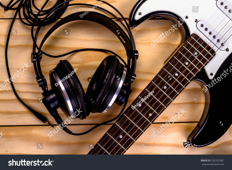 electric guitar music headphones on wooden stock photo 236332387 shutterstock. Black Bedroom Furniture Sets. Home Design Ideas