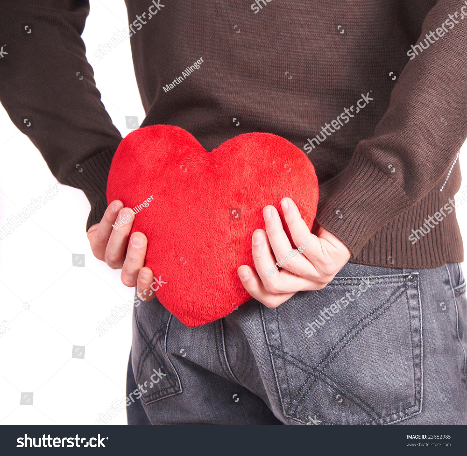 Man Shaped Pillow Young Man Holds Heart Shaped Pillow Stock Photo 23652985