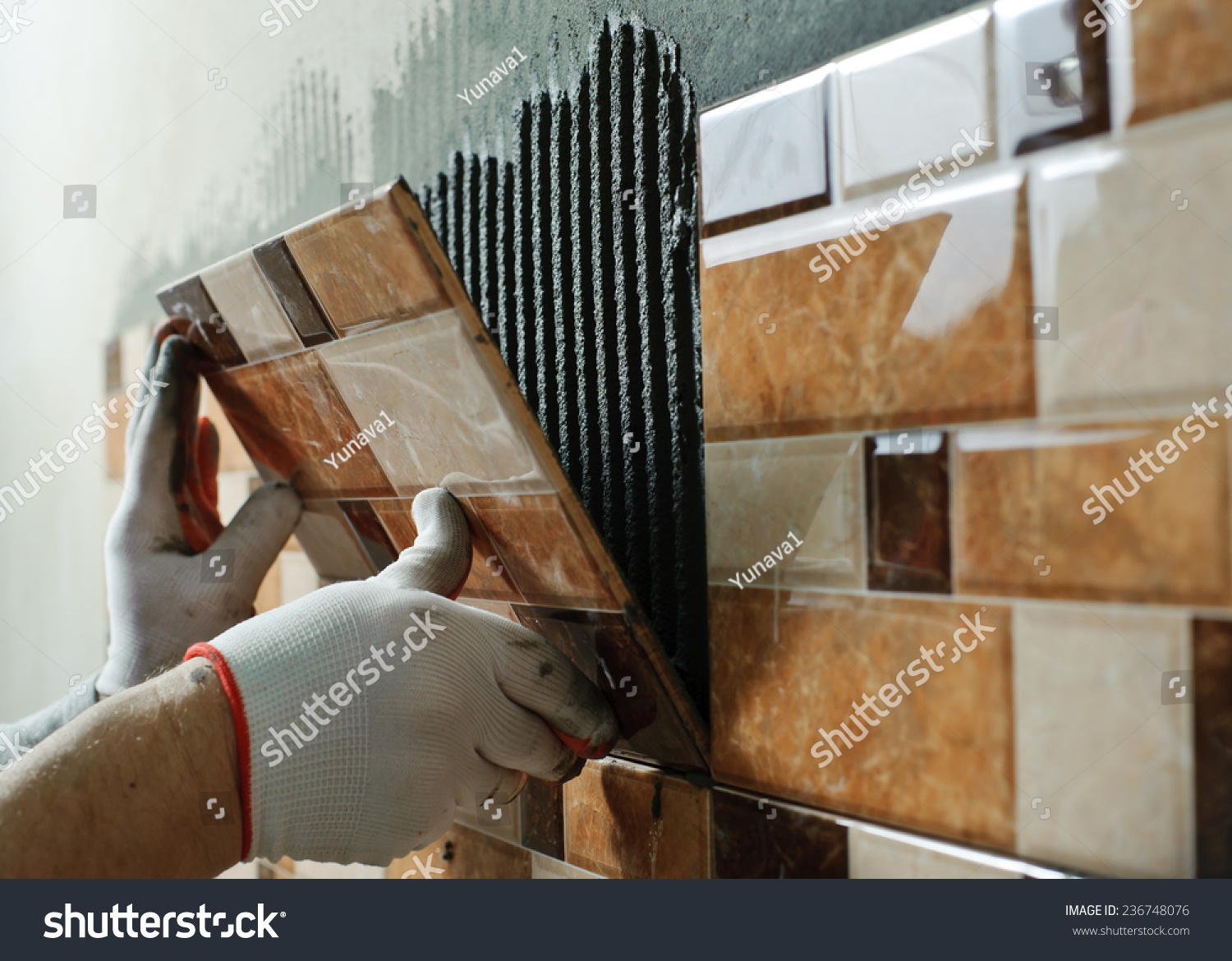 Laying ceramic tiles tiler placing ceramic stock photo royalty free laying ceramic tiles tiler placing ceramic wall tile in position over adhesive dailygadgetfo Gallery