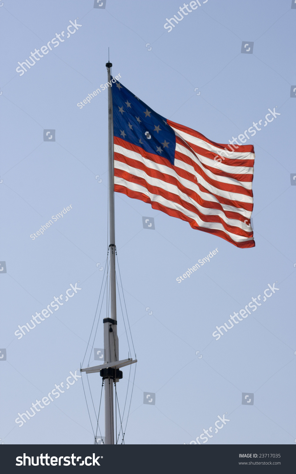 Old glory on flag pole above stock photo 23717035 shutterstock old glory on a flag pole above ft mc henry in baltimore maryland sciox Image collections