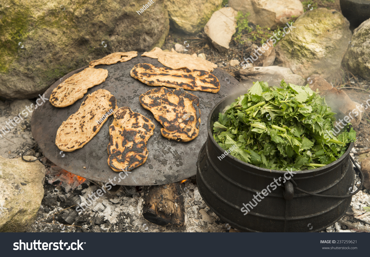 Cooking Cauldron On Burning Campfire Stock Photo (Edit Now