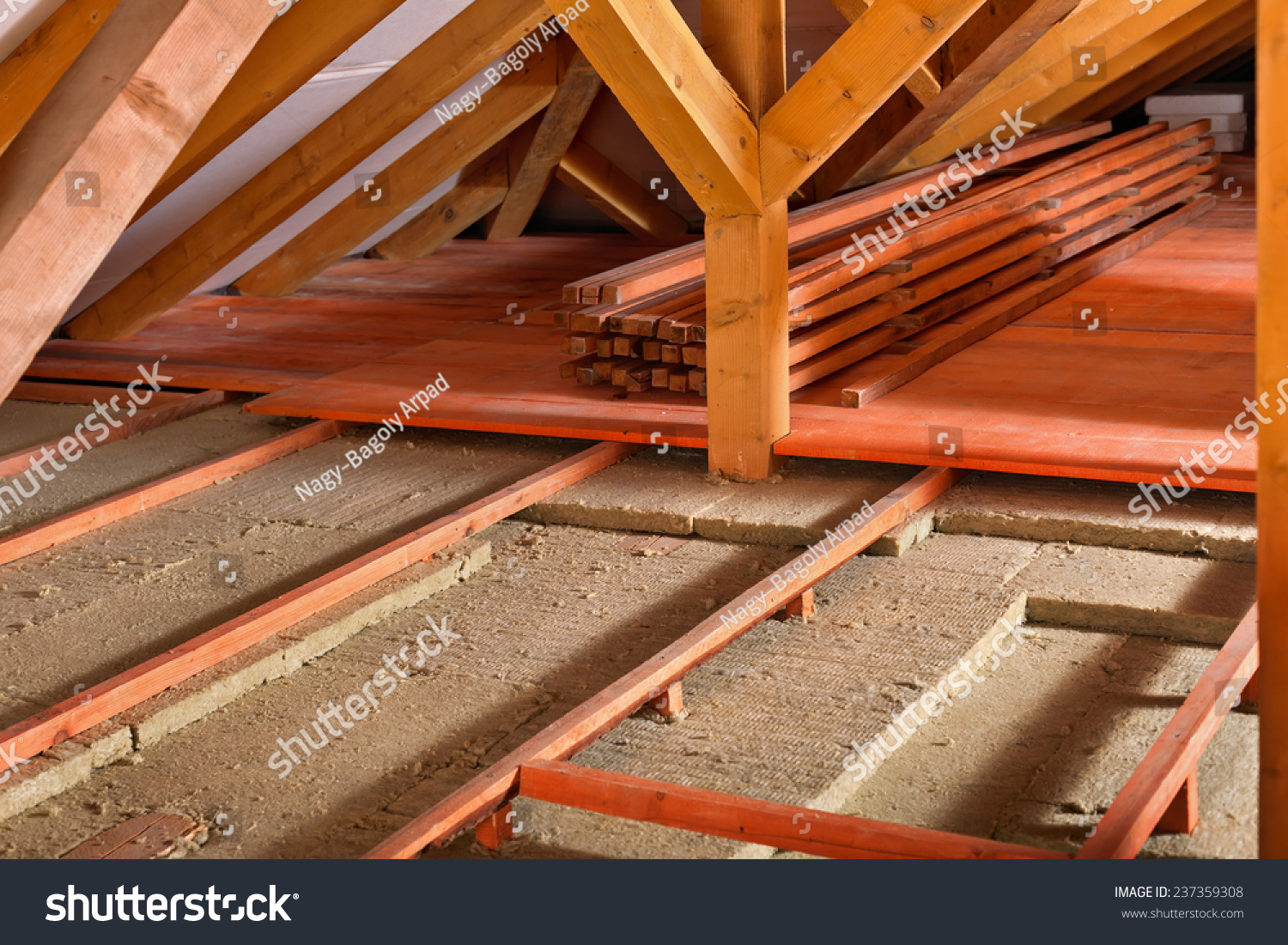 Work site installing thermal insulation using stock photo for Rockwool insulation panels
