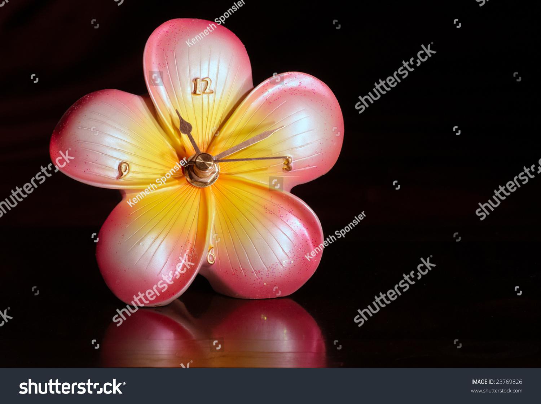Small ceramic clock shape hibiscus flower stock photo edit now small ceramic clock in the shape of a hibiscus flower izmirmasajfo