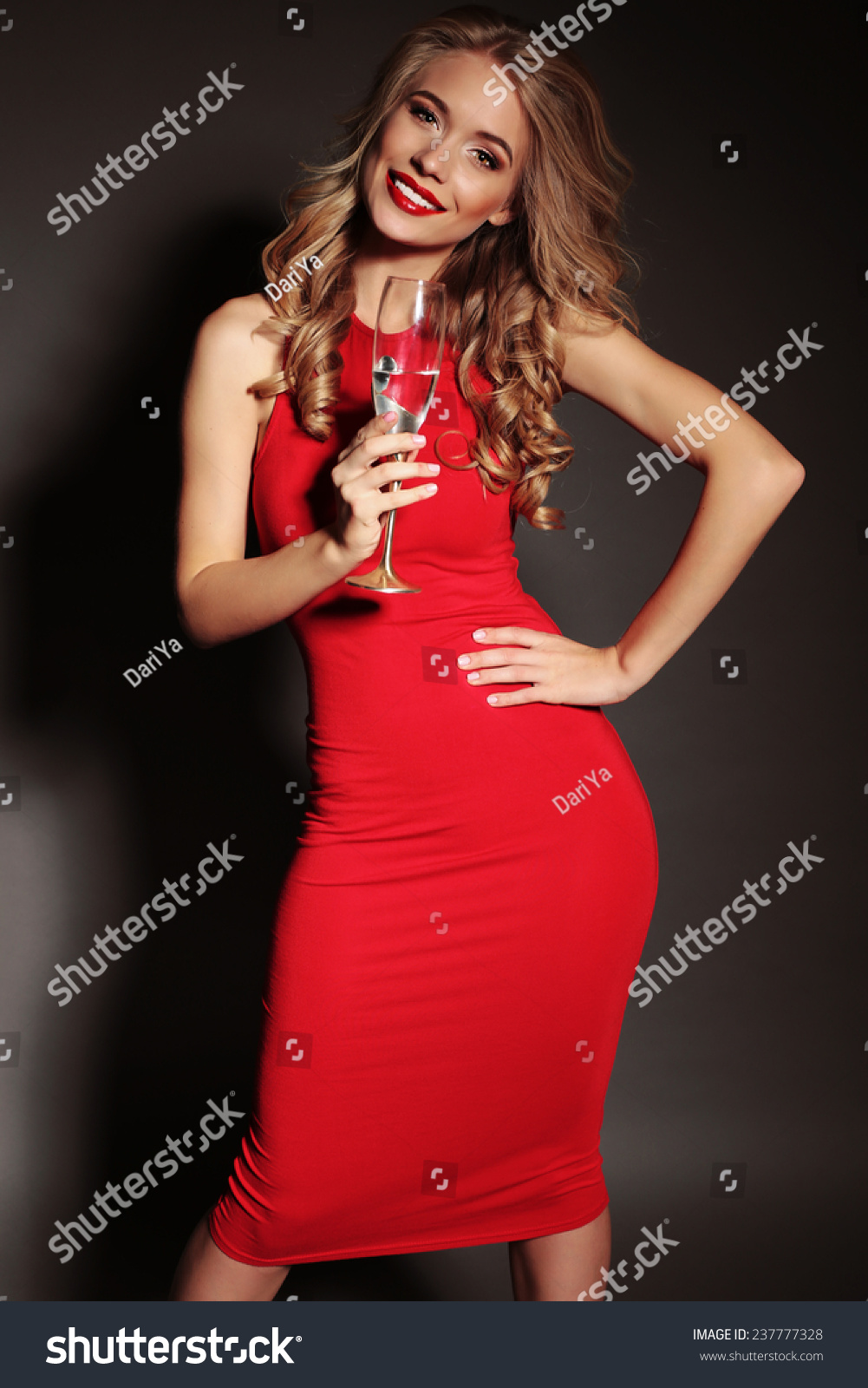 Festive Photo Of Chic Sexy Lady In Red Dress With Red Lips And Blond Beautiful Curly