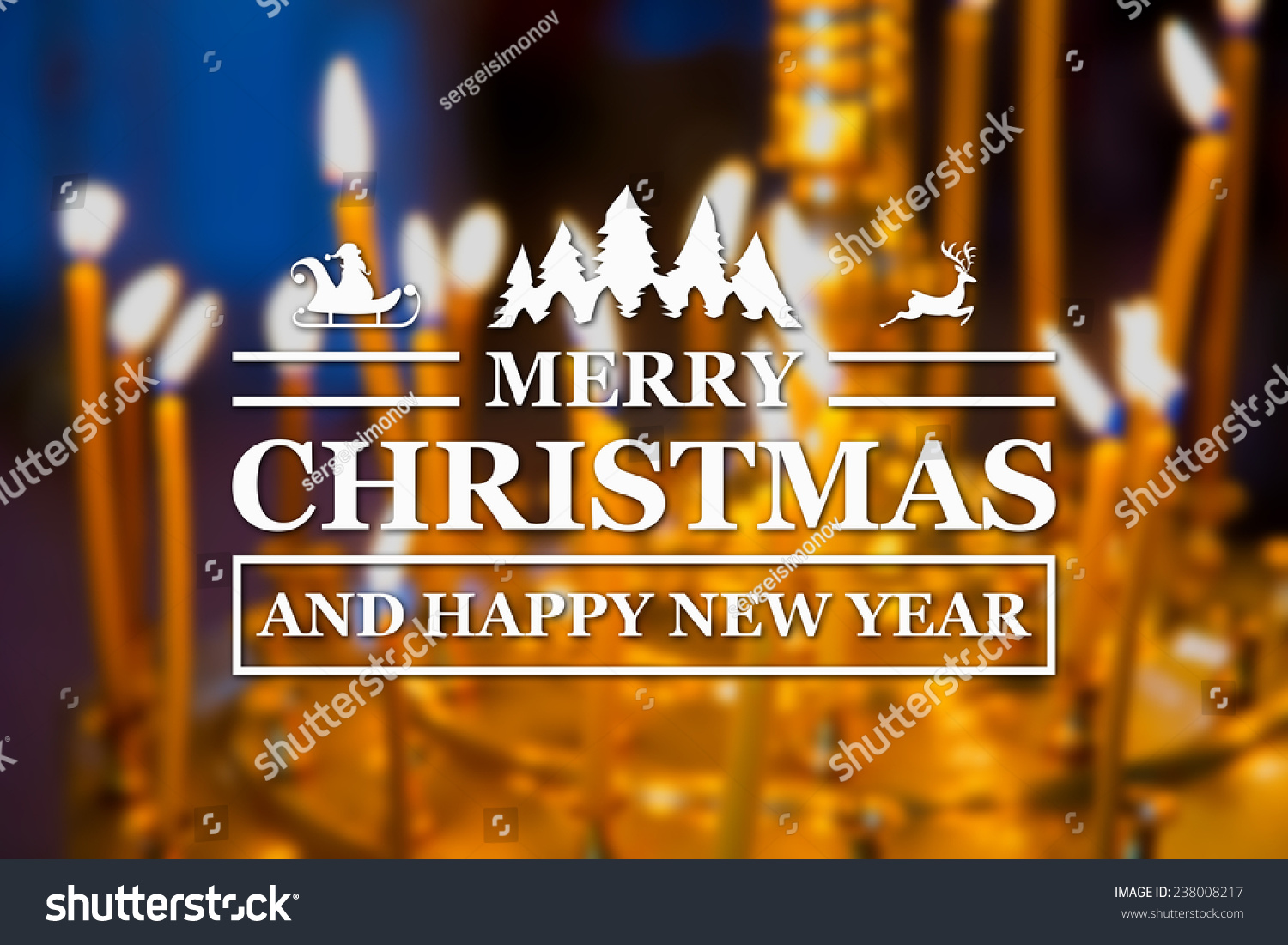 merry christmas and new year greeting card on blurred glowing yellow church candles on background