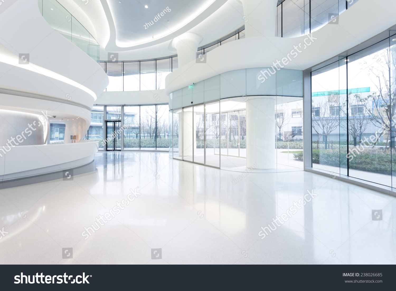Futuristic modern office building interior in urban city for Modern office building interior