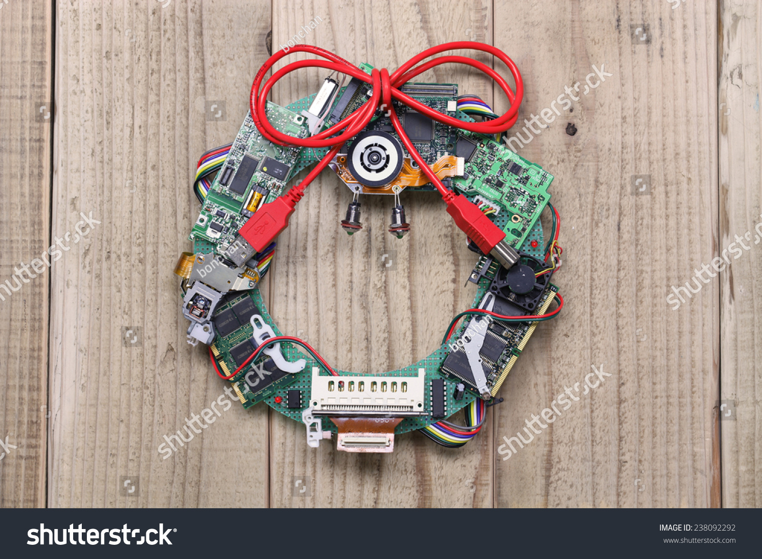 Wreath from old christmas cards - Geeky Christmas Wreath Made By Old Computer Parts Hanging On Wooden Door Computer Parts Recycling