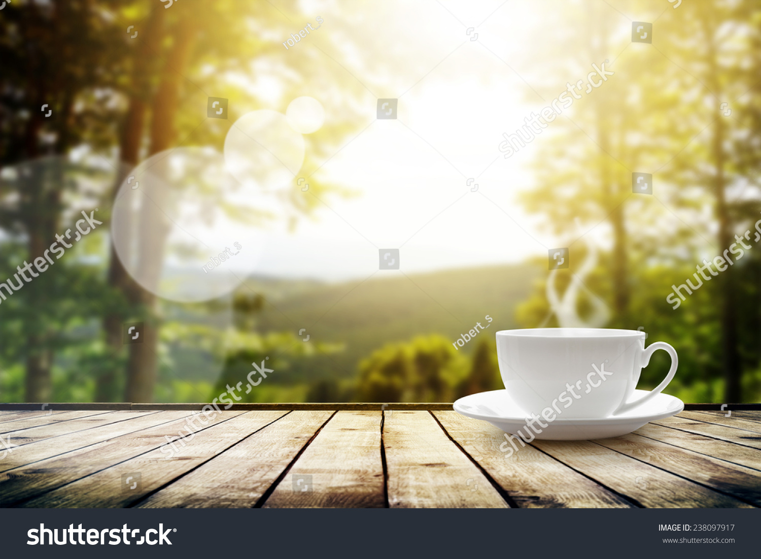 Cup tea on table over mountains stock photo 238097917 shutterstock cup with tea on table over mountains landscape with sunlight beauty nature background geotapseo Gallery