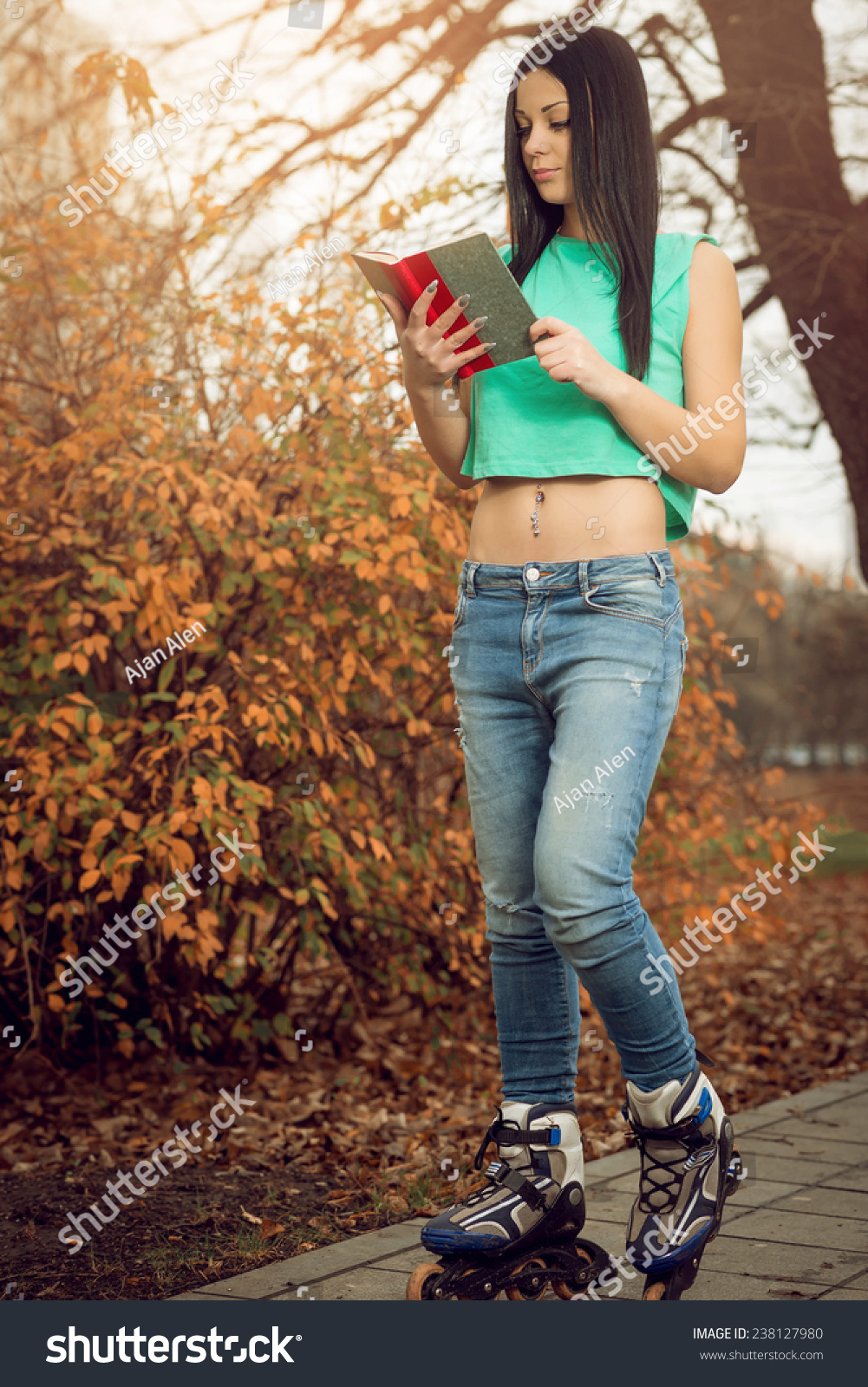 Roller skates book - Young Adult Girl Reading A Book On Roller Skates In Park Outdoor