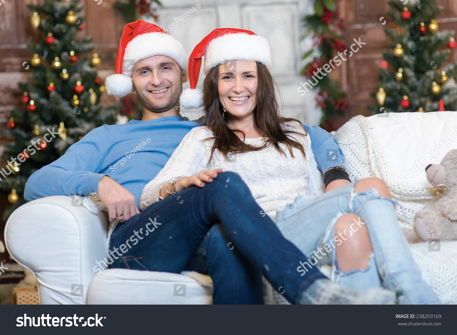 merry christmas and happy new year couple in love is sitting in festive christmas decorated