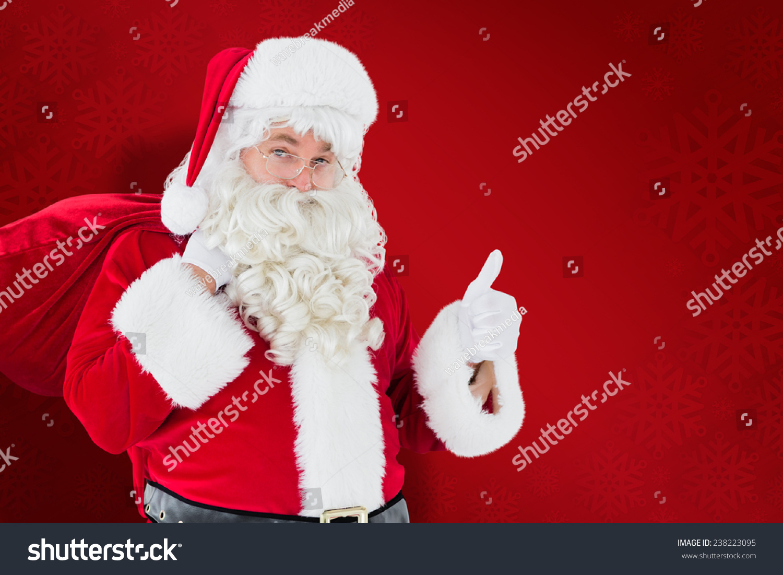 Santa Claus His Sack Thumbs Against Stock Photo 238223095