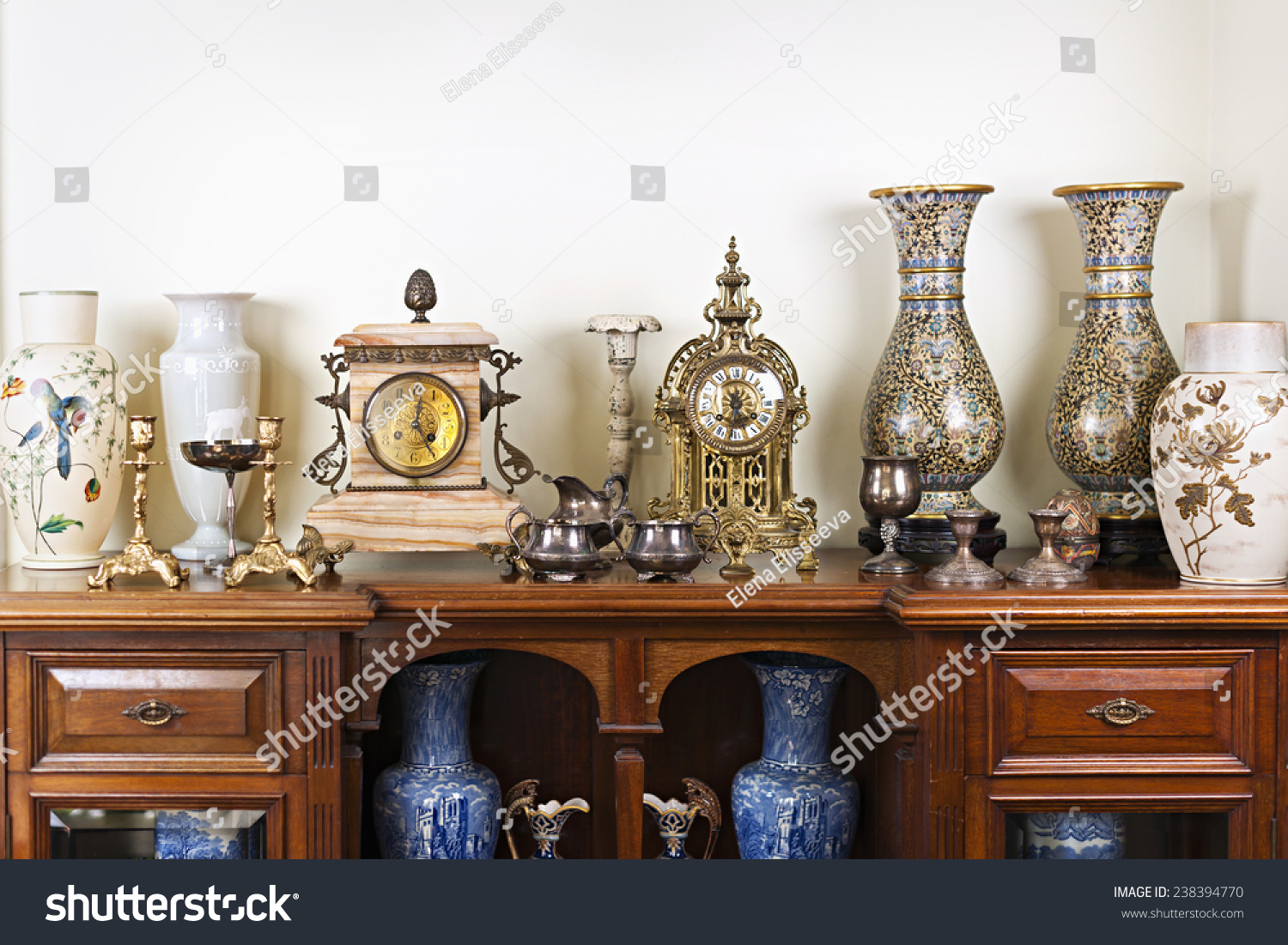 Various antique clocks vases and candlesticks on display #238394770