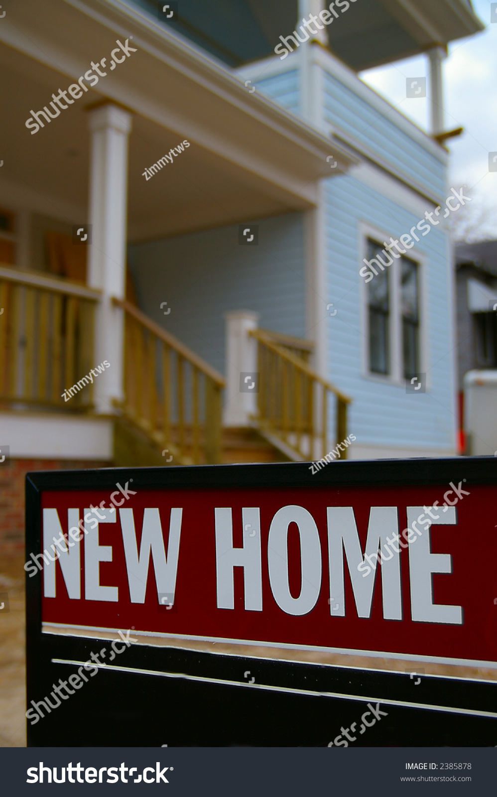 House with closeup of new home sign stock photo 2385878 for New home sign