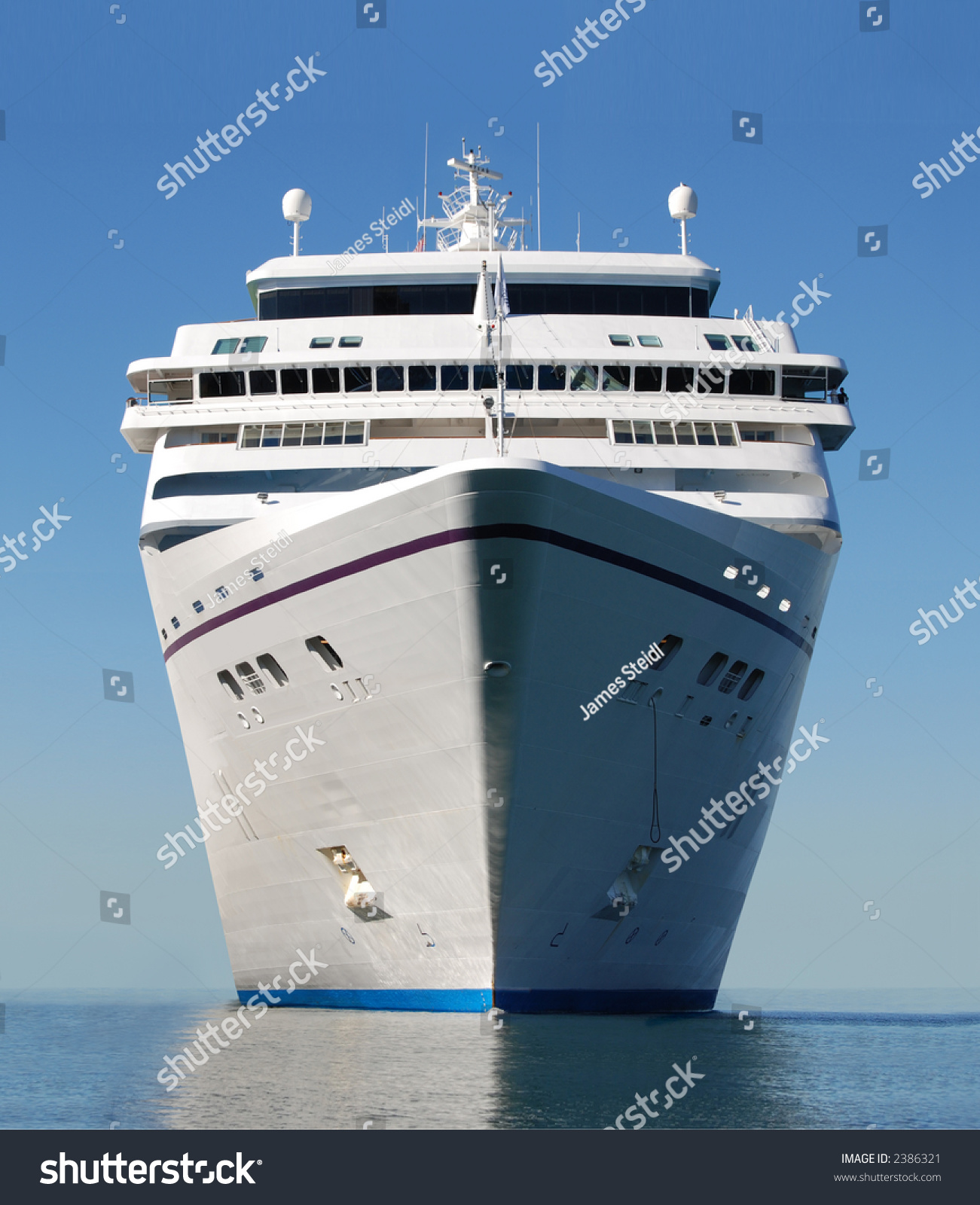 Water Level View Of Cruise Ship Facing The Bow Stock Photo