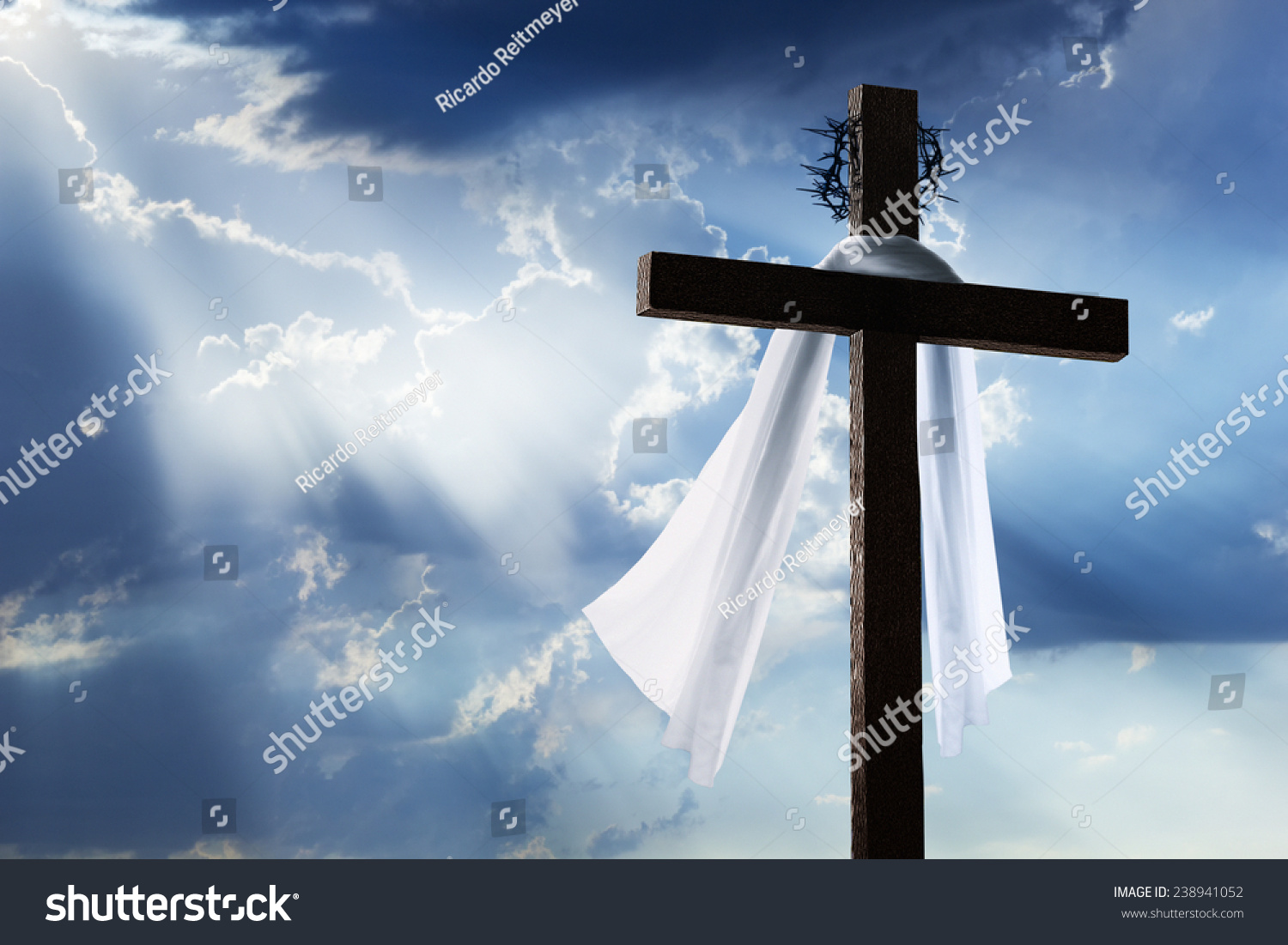 Silhouette of the holy cross on background of storm clouds stock - Beautiful Blue Sky With Clouds And Sunbeams Shining On A Cross For Easter Morning The