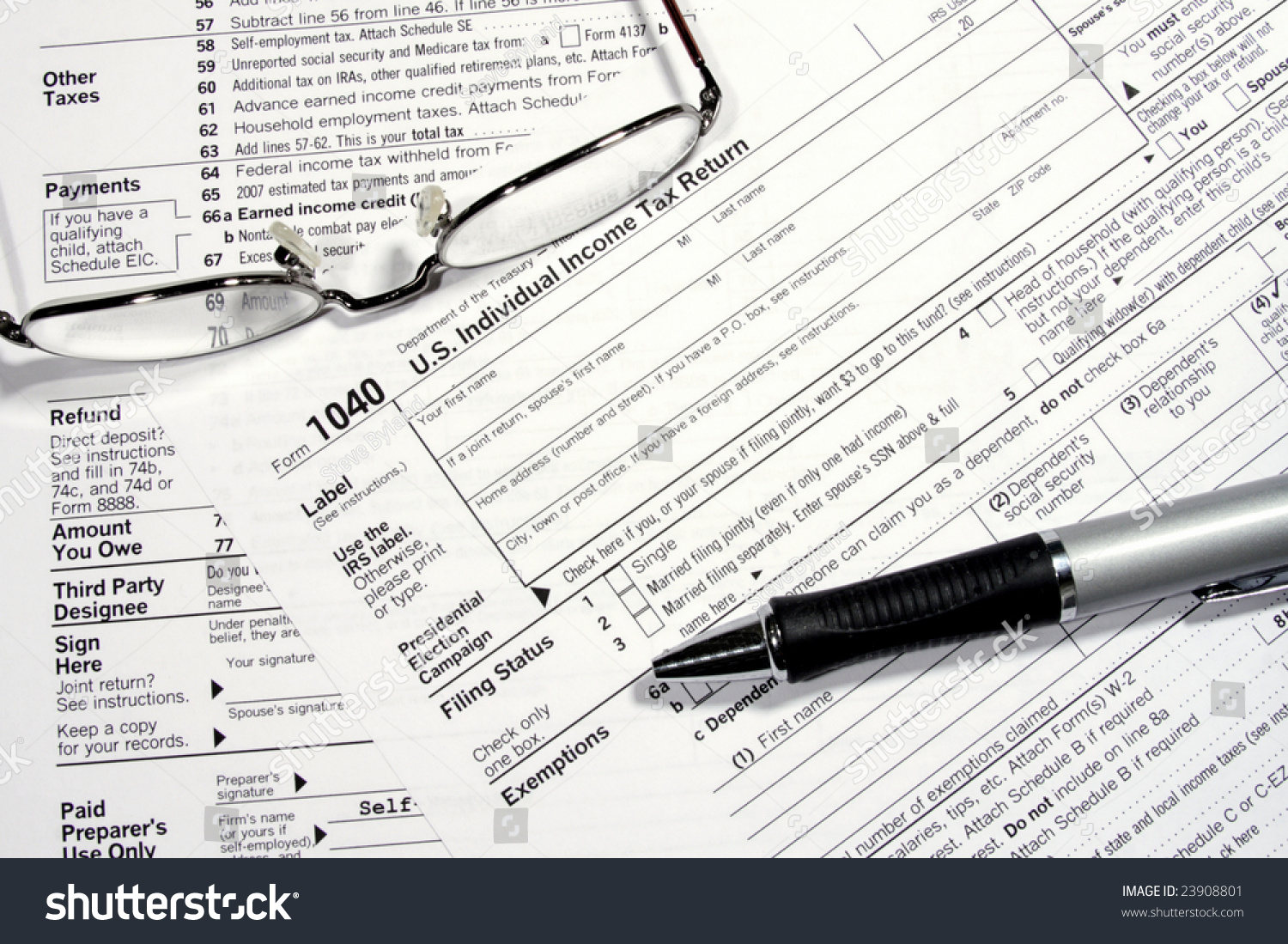 USA IRS tax form 1040 for year 2017 with pen and taken from above ...