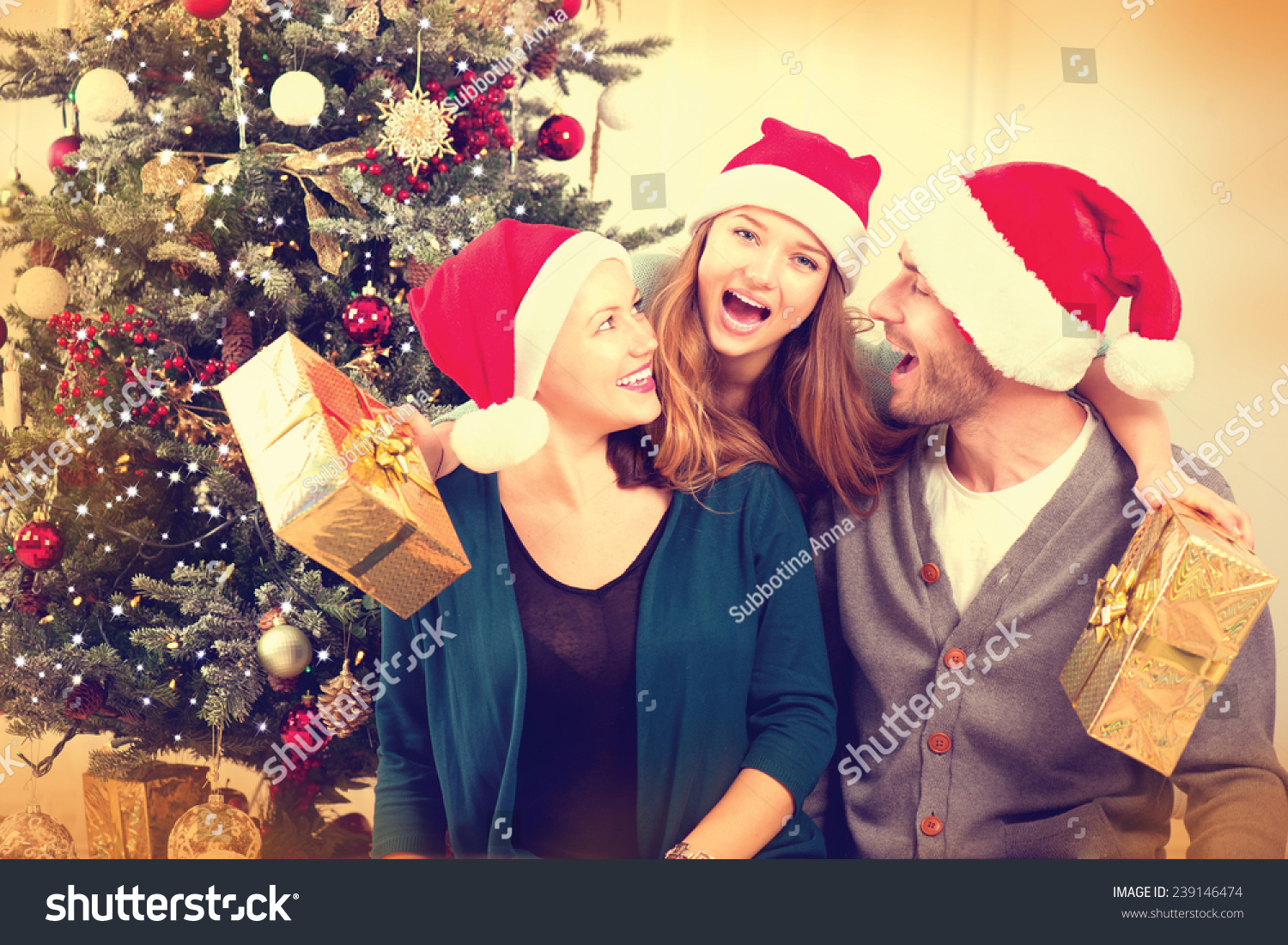 happy christmas family with christmas gifts smiling parents with teenage daughter at home celebrating new