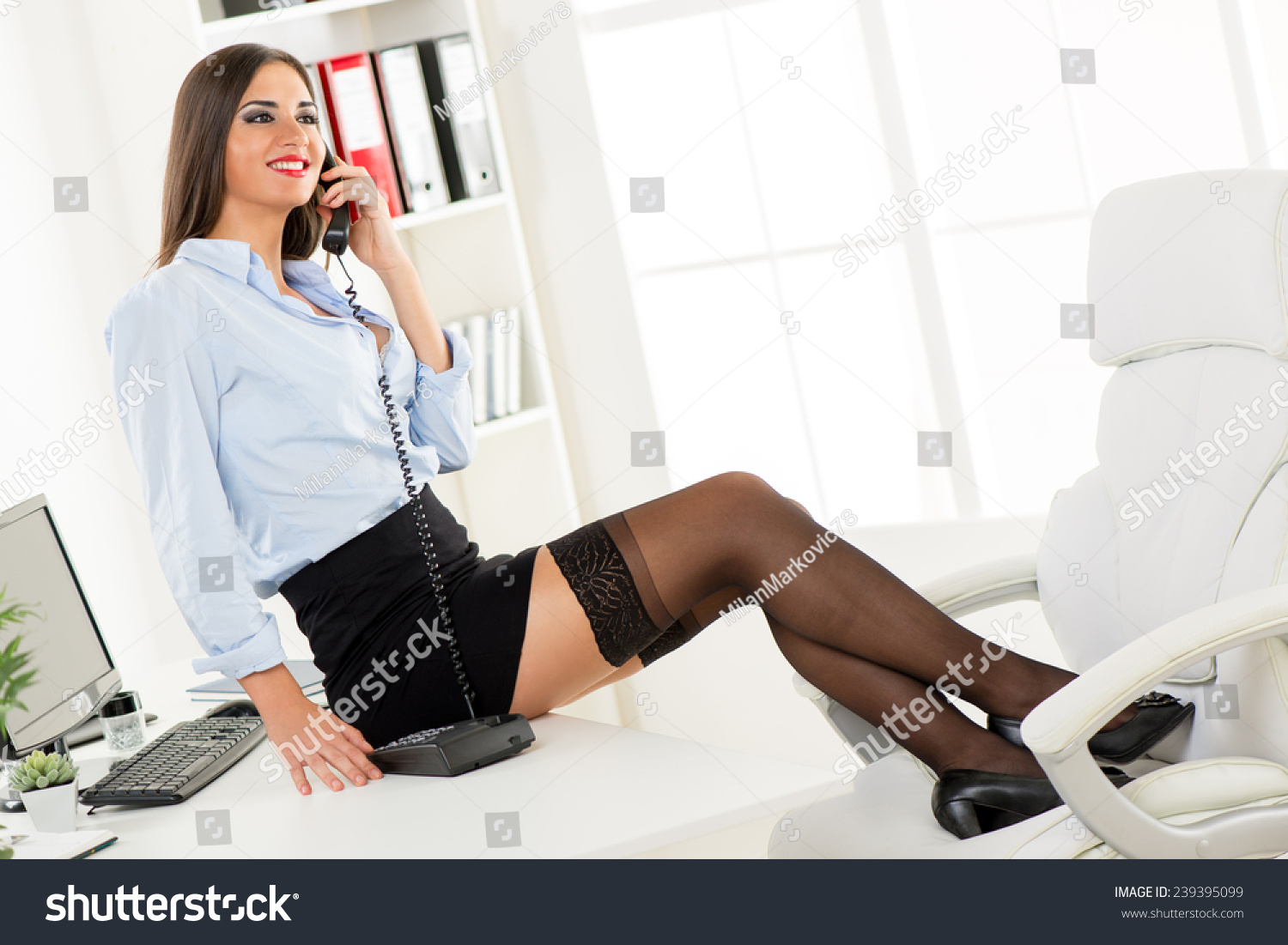 Young Pretty Businesswoman Short Skirt Sitting Stock Photo ...