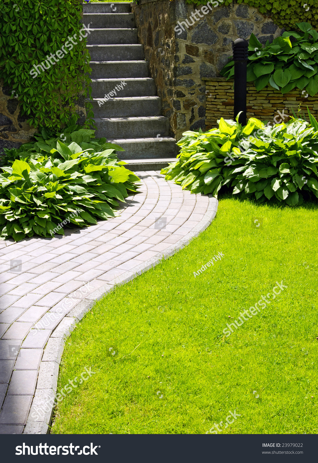 Garden Stone Path With Grass Growing Up Between The Stones ...
