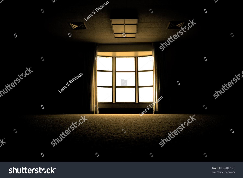 Dark room with light through window - Large Dark Room With Bright Light Coming In Through Paned Window