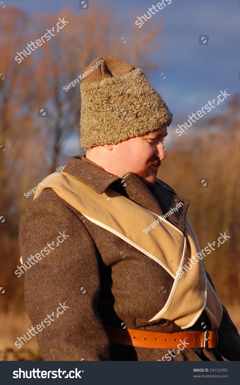 KIEV, UKRAINE - FEBRUARY 2, 2008. A member of the military history reenactment club, Red Star, wears a recreation of historical military Russian Civil War uniform circa 1918 in Kiev, Ukraine on February 2, 2008.