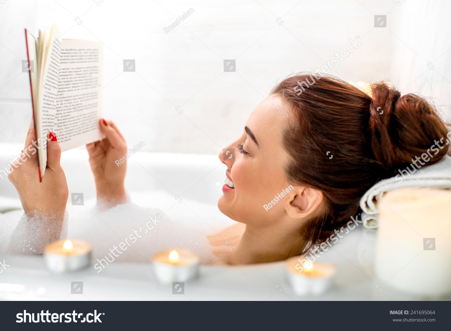 Young Woman Reading Book While Lying Stock Photo (Edit Now ...