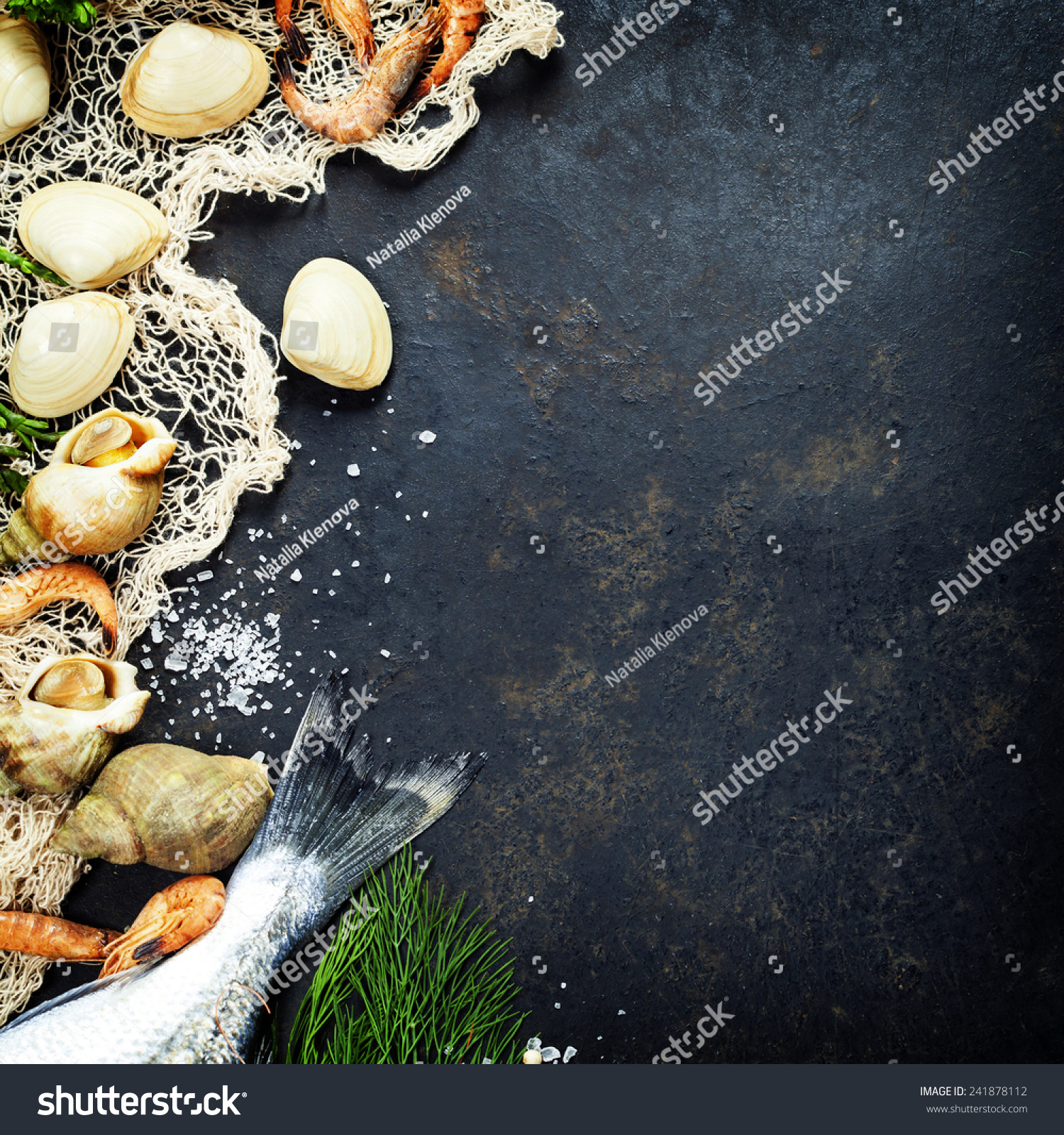 Delicious fresh fish and seafood on dark vintage for Aromatic herb for fish