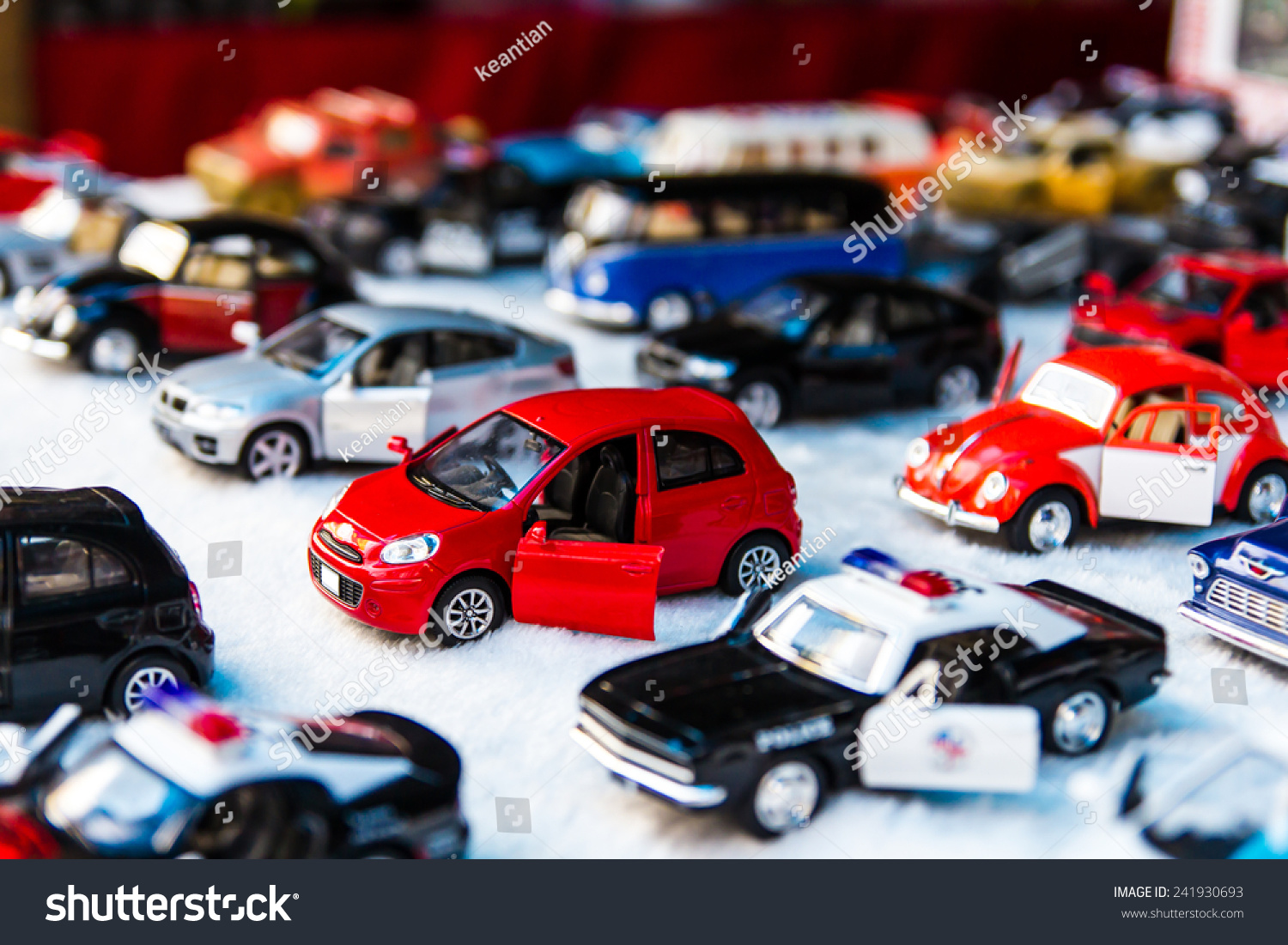 Fabric Roads For Toy Cars : Many small toy cars lined on stock photo