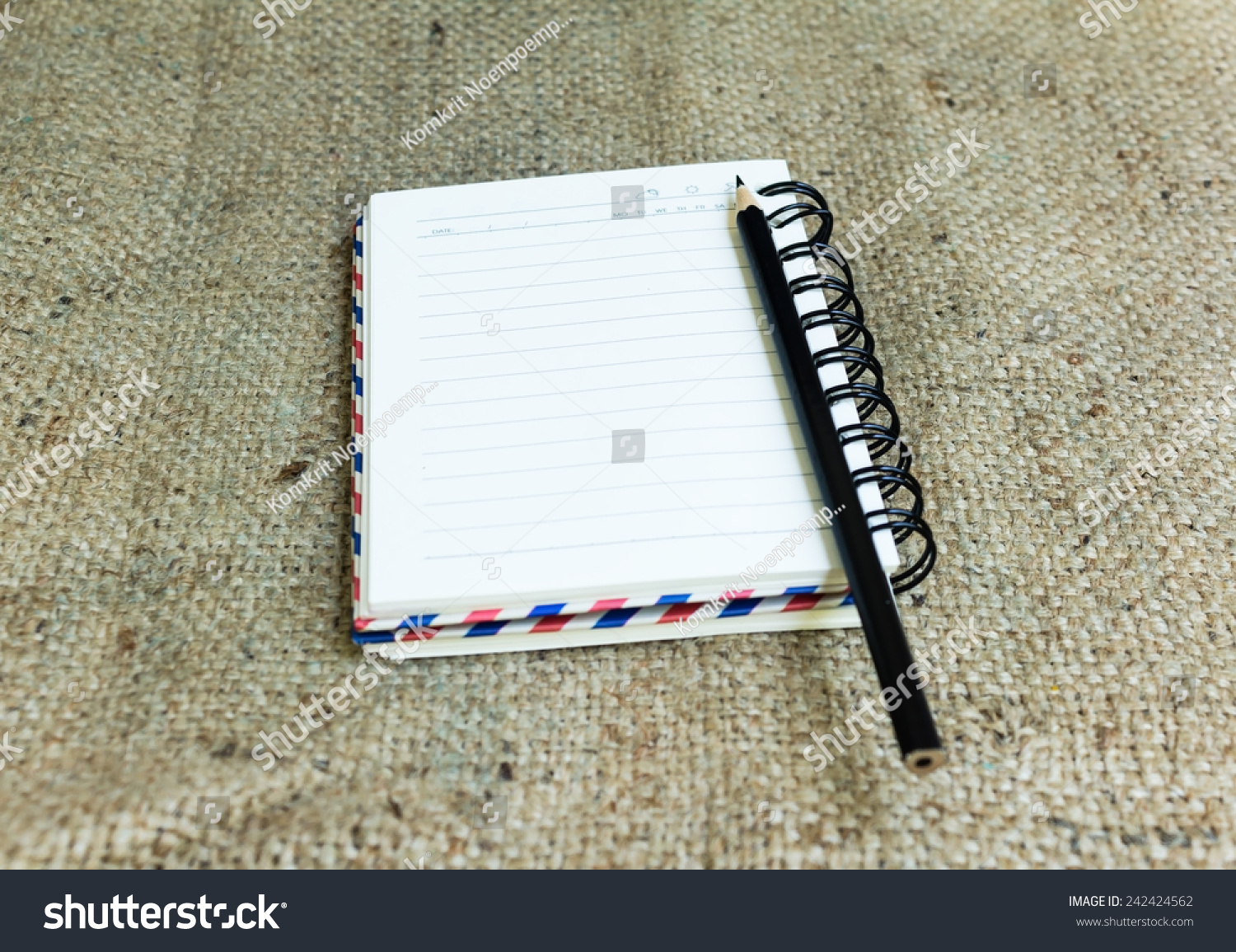 Blank notebook with pencil on sack background Vintage effect style pictures