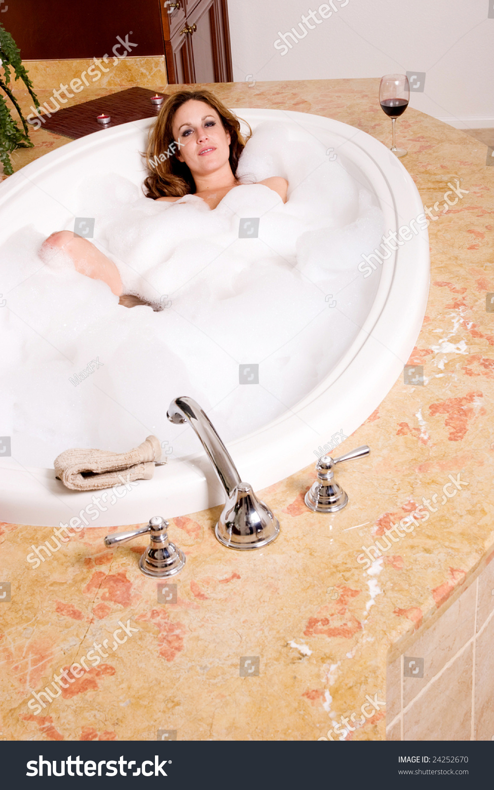 Sexy woman taking a bath