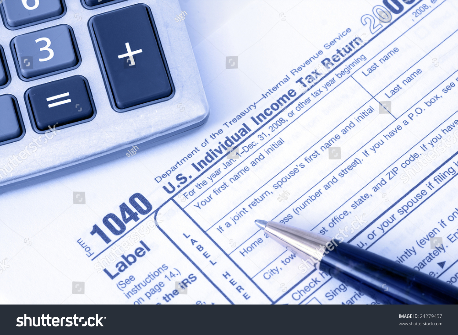 Pen with calculator over 1040 tax form with blue overlay for 1040 tax table calculator