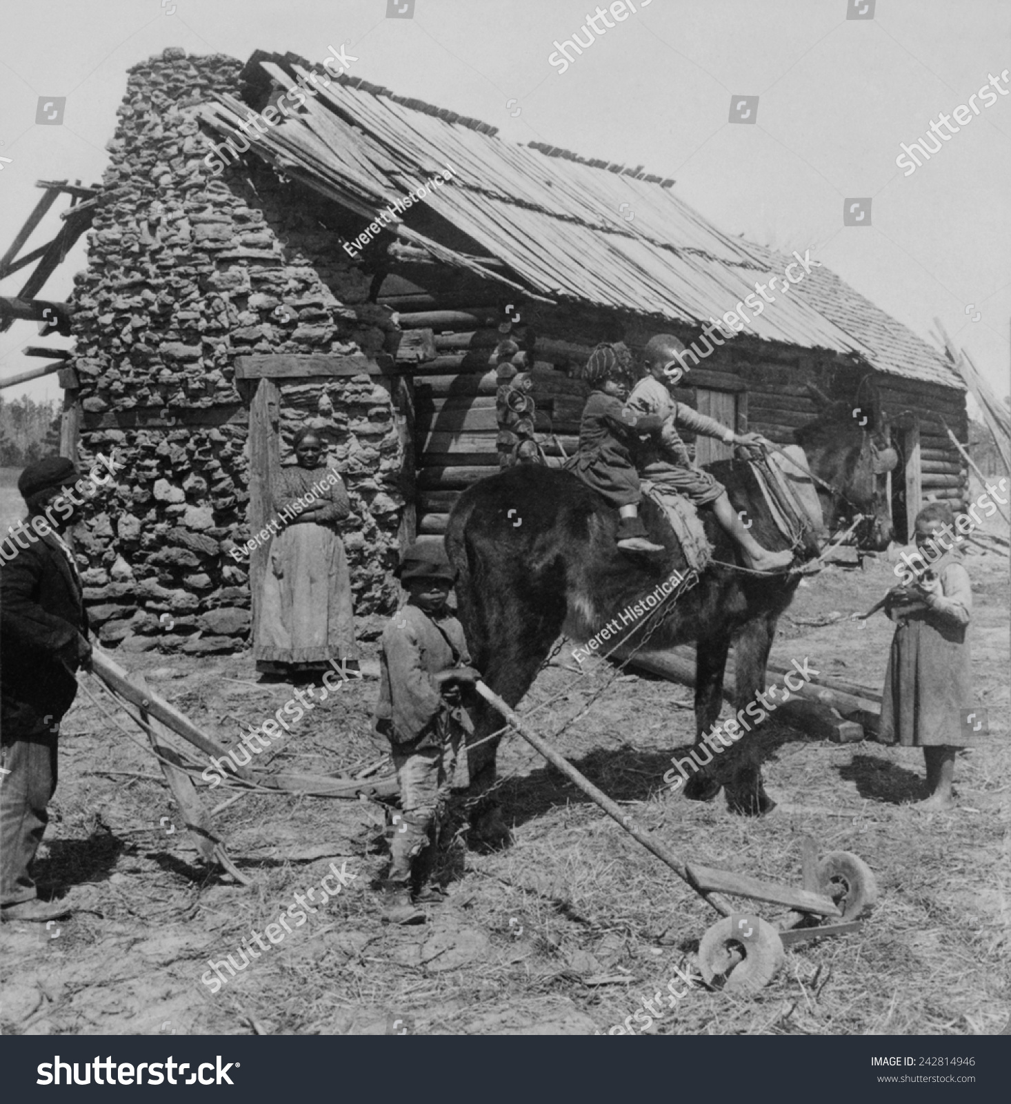 African American Farm Family Outside Their Stock Photo