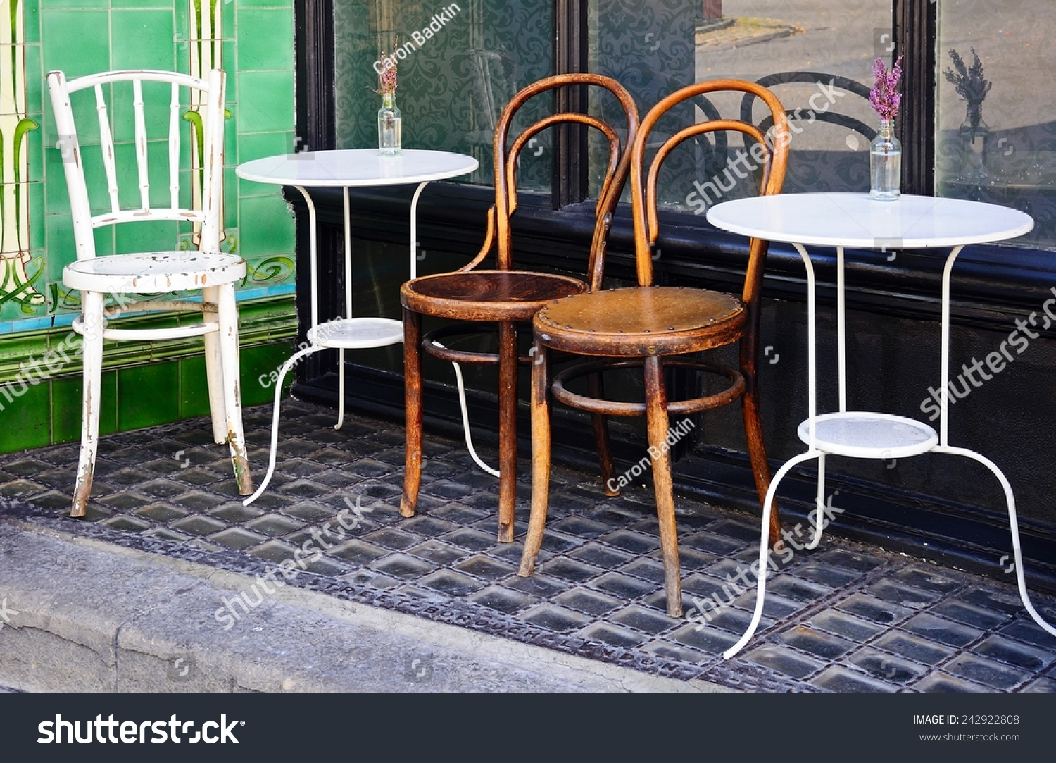 tables chairs outside town centre cafe stock photo royalty free