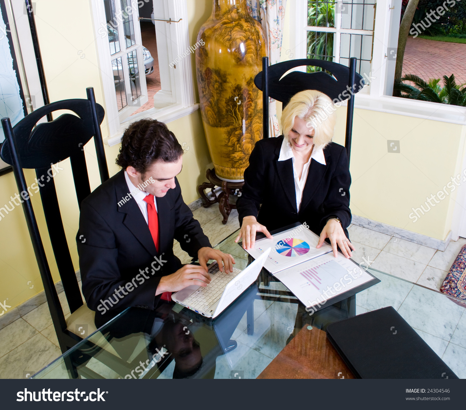 Realtor meets client home painting on stock photo 24304546 a realtor meets with a client at home painting on vase is ancient chinese art reviewsmspy