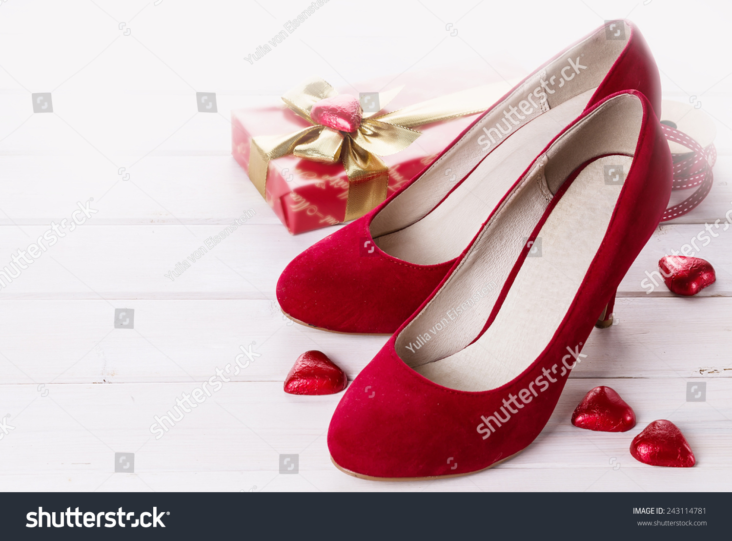 Valentine Day Items   Pair Of Red Shoes, Gift Box And Red Chocolate Hearts  Over