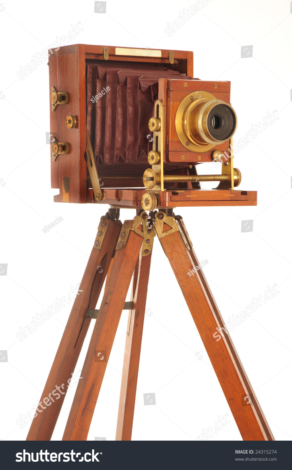 Very Old Camera On Wooden Tripod Stock Photo 24315274