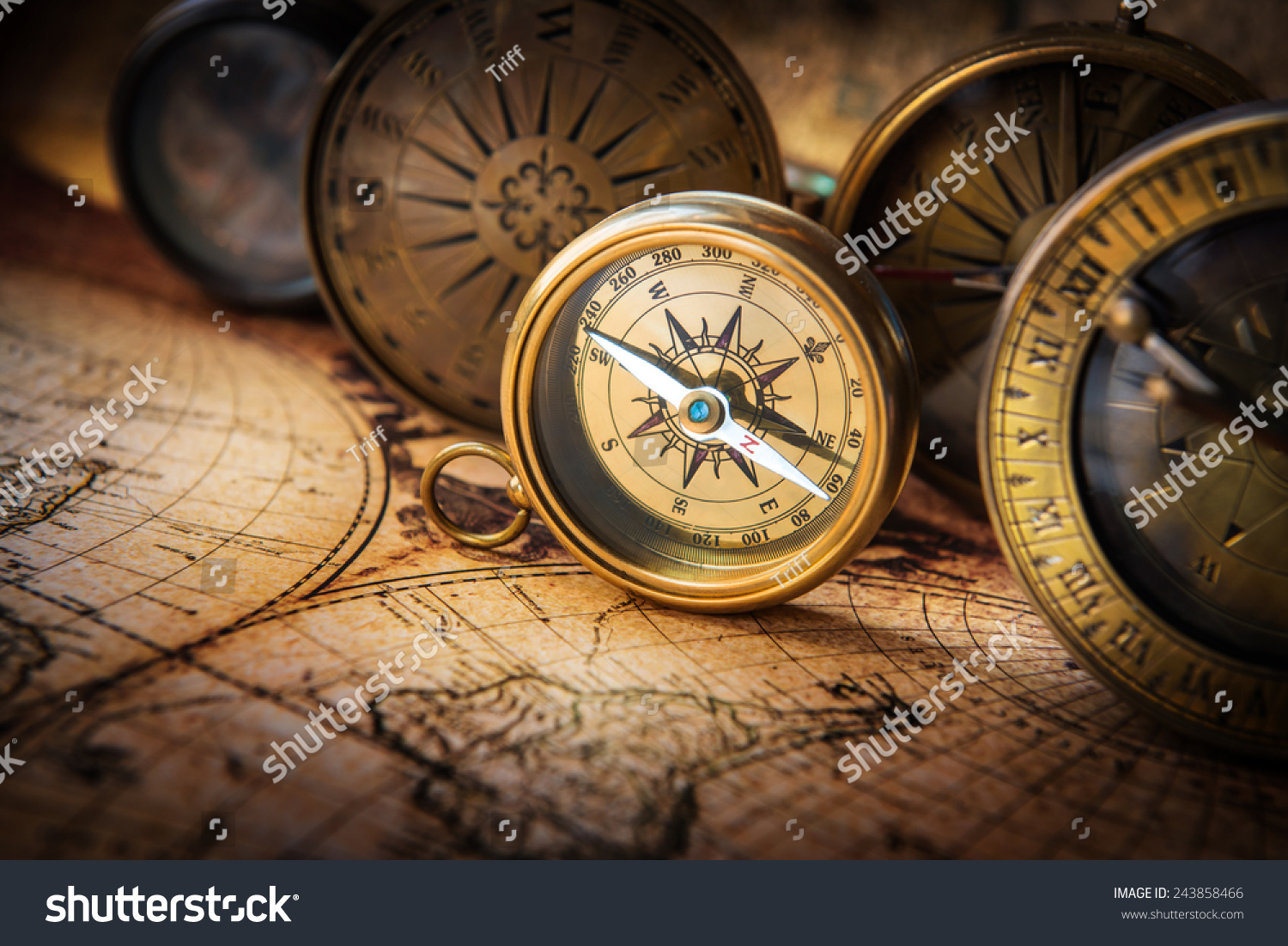 Old Compass On Vintage Map. Retro Stale. Stock Photo