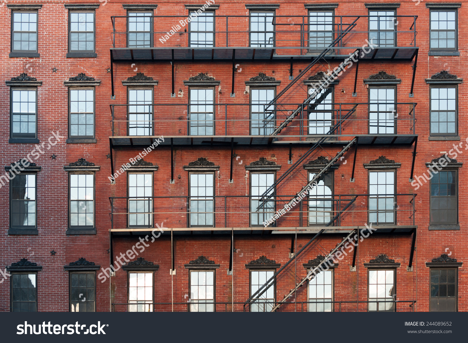 old brownstone apartment building center city stock photo 244089652 shutterstock. Black Bedroom Furniture Sets. Home Design Ideas