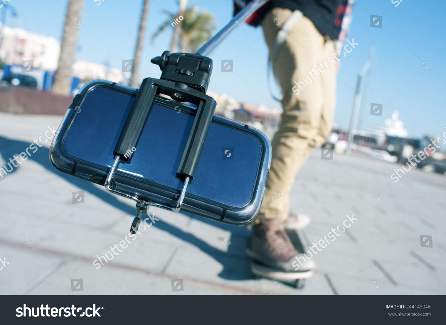 a skater taking a self portrait with a selfie stick stock photo 244149046 shutterstock. Black Bedroom Furniture Sets. Home Design Ideas
