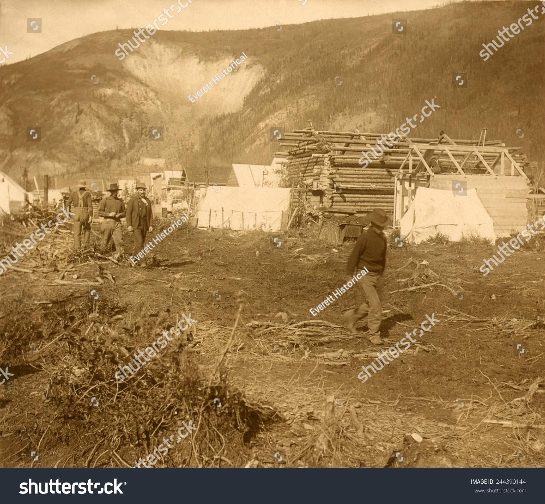 Men Walking On Dawson Citys Riverside Stock Photo (Edit Now