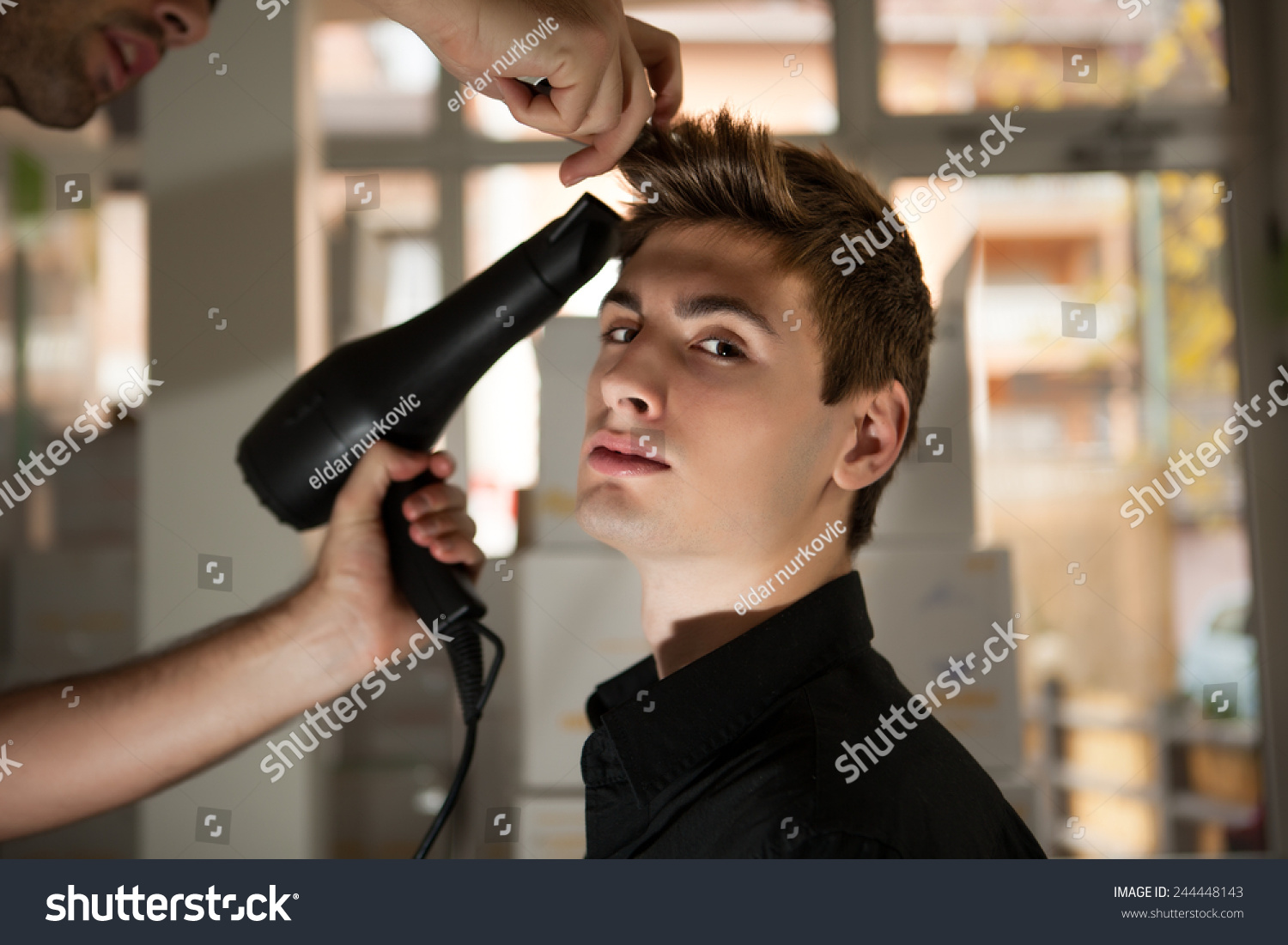 Young Man Using Hairdresser Making Haircut Stock Photo