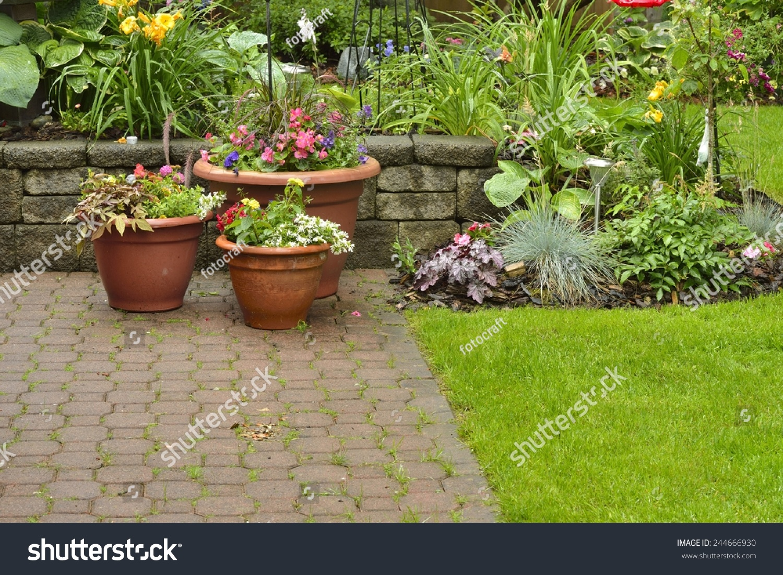 Yard patio beautiful residential garden flower stock photo edit now yard and patio beautiful residential garden with flower pots mixed with perennials and annuals izmirmasajfo