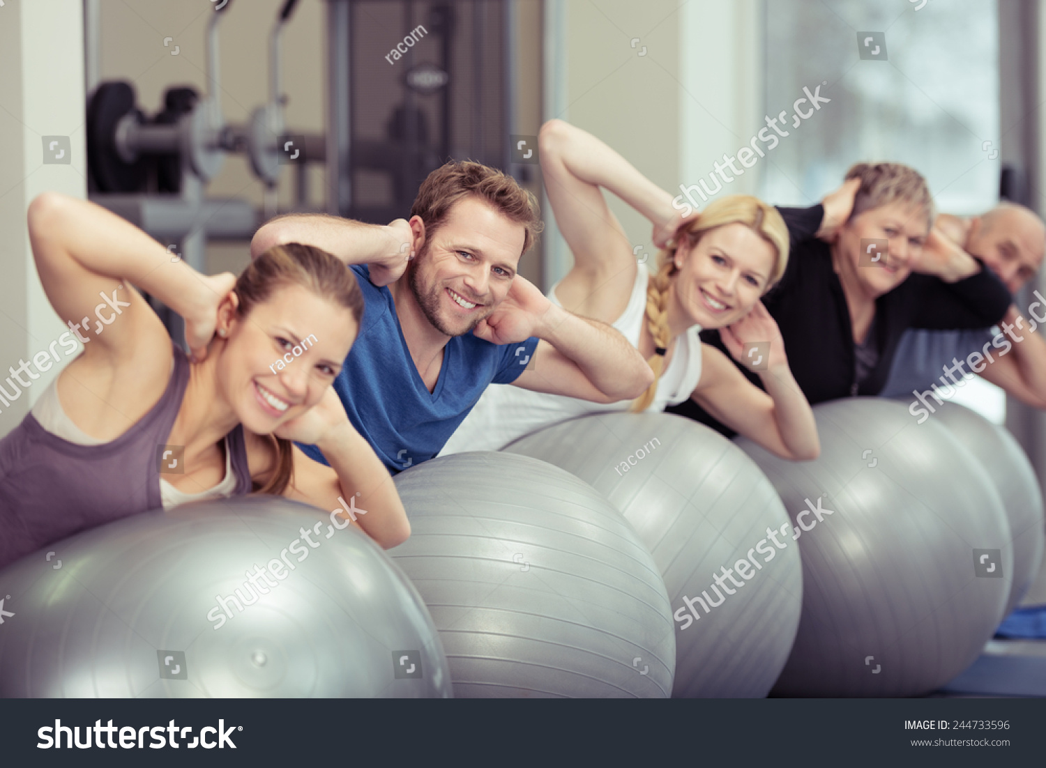 the three groups of people inside the gym Cooperative games to have two groups, of at least three people each and right leg inside a second hoop the side groups then connect to the opposite sides oh.